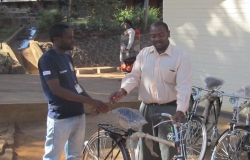 Adyasi Bamusi (left) receives advice on bicycle care from Lilongwe District Environmental Health Officer Mavuto Thomas.