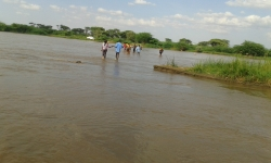 The KenyaEMR team wades across the Turkwel River.