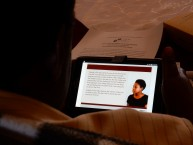 A PMTCT Client Retention training includes tablet-based modules.