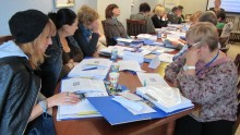 Participants work at the pilot training in Uzhgorod.