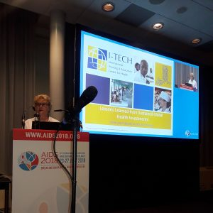 Ann Downer gives a presentation at the AIDS 2018 Conference.